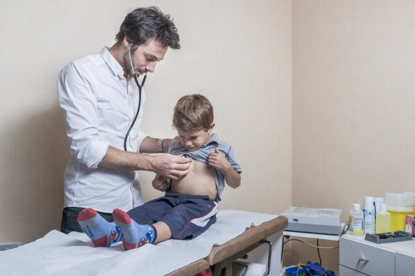Child being examined by a doctor, France